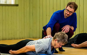 Julian Askham teaching Pilates at Hickling Barn